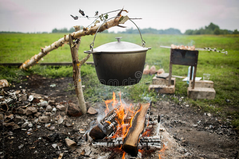 Download A Cooking Fish Soup In Pot On Bonfire Stock Image