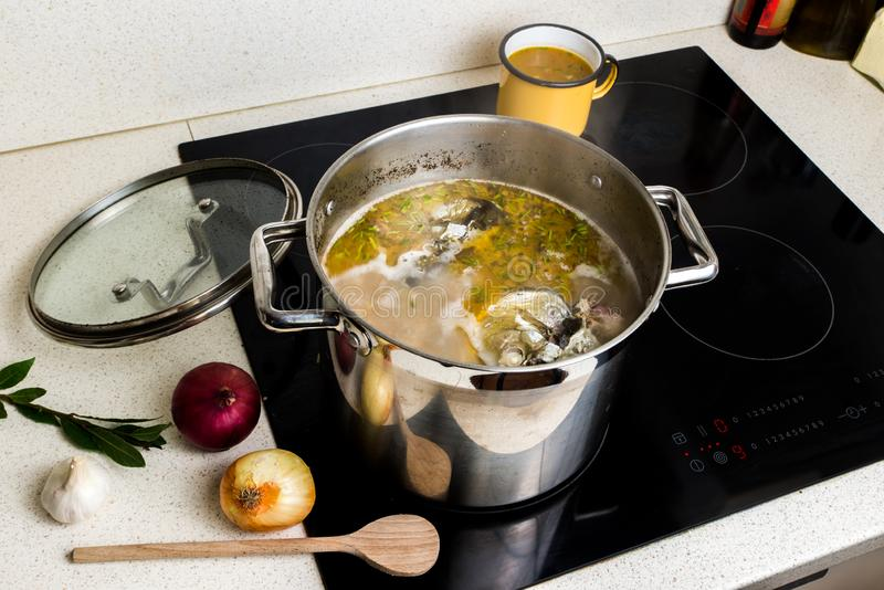 Cooking fish soup in pot stock image