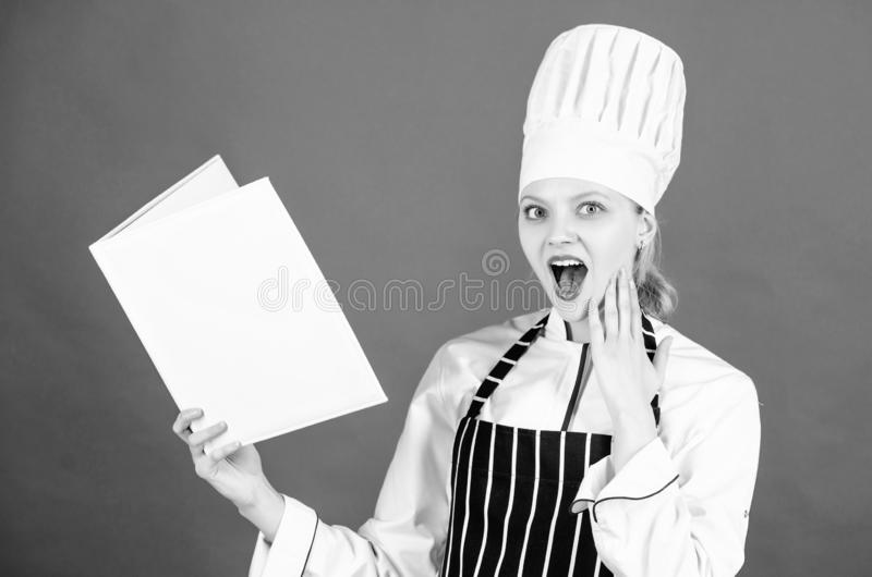 Cooking food and culinary as hobby. Woman reading cook book in kitchen. Tips and advice. Cooking food. Delicious and stock photo