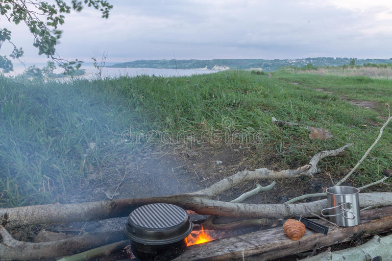 Cooking food at the stake. Picnic on the river bank. Landscapes. royalty free stock photo
