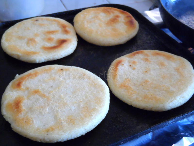 Cooking four arepas stock image