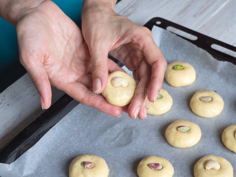 Cooking of Ghorayeba sweets. Eid eats. Cookies of El Fitr Islamic Feast. royalty free stock image