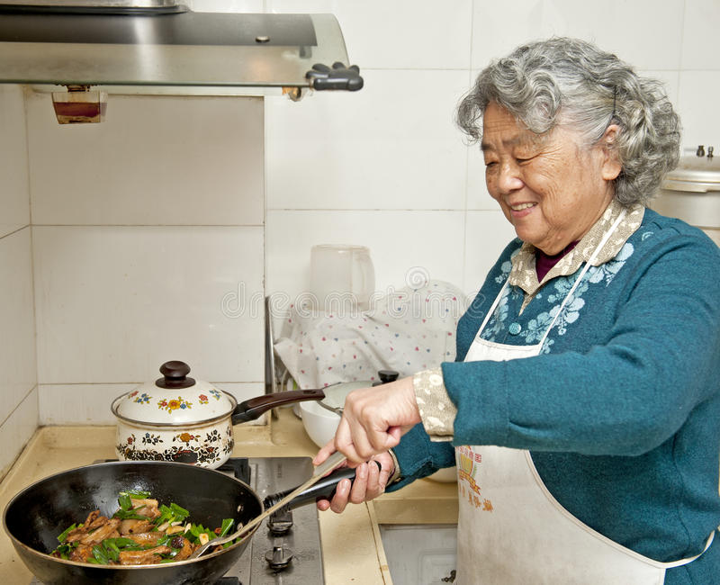 Cooking Grandmother Stock Photo