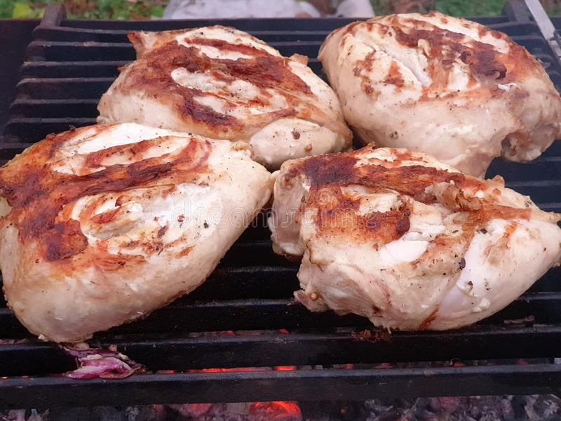 Cooking grilled chicken on a barbecue grill royalty free stock images