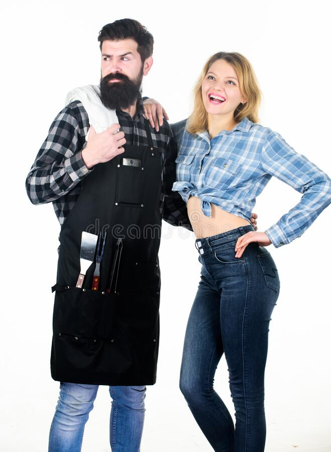 Cooking healthy. Family weekend. Picnic barbecue. food cooking recipe. Couple in love hold kitchen utensils. Man bearded. Hipster and girl. Preparation and stock image
