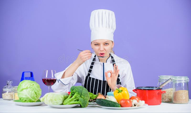 Cooking healthy food. Fresh vegetables ingredients for cooking meal. Professional cooking tips. Woman chef try taste stock images