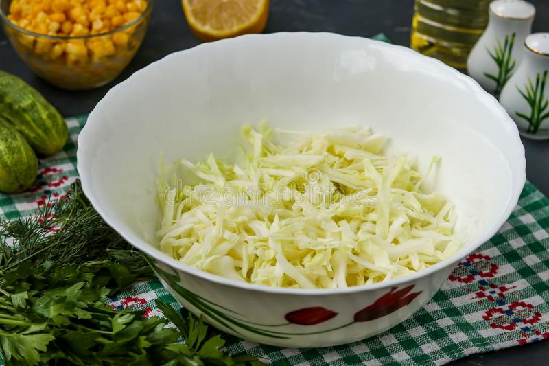 Cooking healthy salad with cabbage, horizontal photo, slicing cabbage into strips stock photos