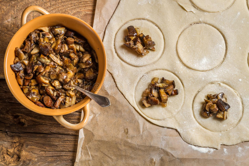 Cooking homemade dumplings with mushrooms stock images