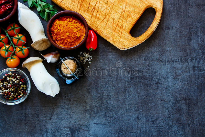 Cooking ingredients background. Delicious colorful farm vegetables and ingredients for healthy cooking on rustic background, border, top view. Vegetarian or diet stock photo