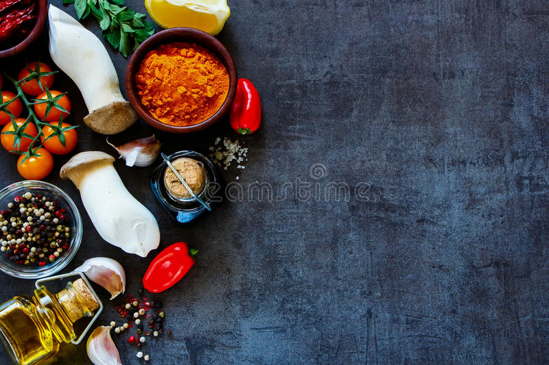 Cooking ingredients background. Top view of colorful farm vegetables and ingredients for healthy cooking on rustic background with space for text, border stock photography