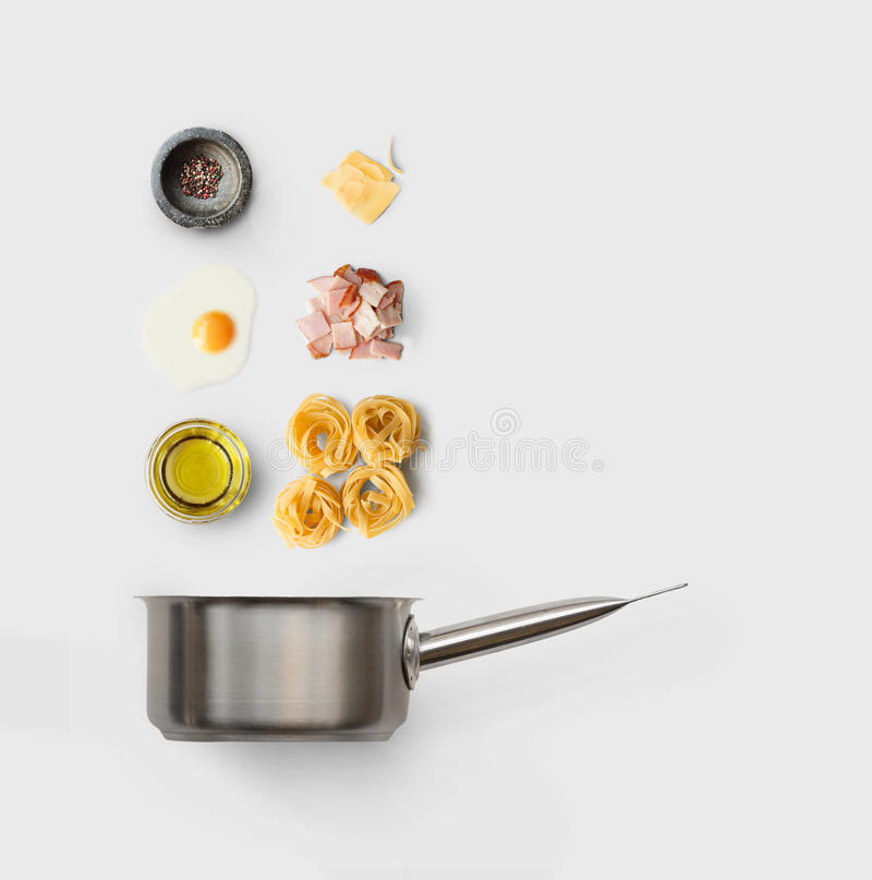 Cooking ingredients for italian food, carbonara, isolated on white. Cooking italian food collage. Ingredients for carbonara pasta, spaghetti, oil, ham, egg and stock images