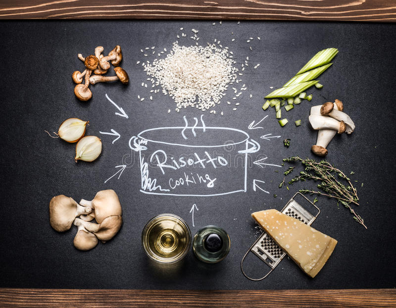 Cooking Ingredients for mushrooms risotto with hand drawings on dark chalkboard royalty free stock photography