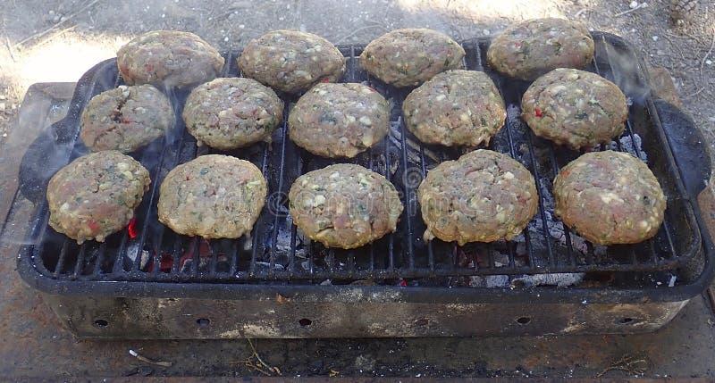Cooking kebabs of lamb royalty free stock photography