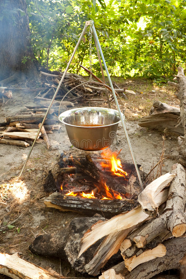 Download Cooking in kettle stock photo. Image of fire, tripod - 11814396