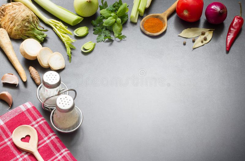 Cooking in the kitchen food background concept with spices vegetables ingredients and free copy space royalty free stock photo