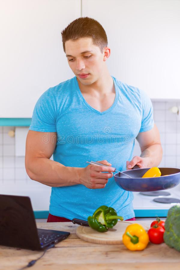 Cooking man vegetables recipe computer portrait format eating. Laptop stock images