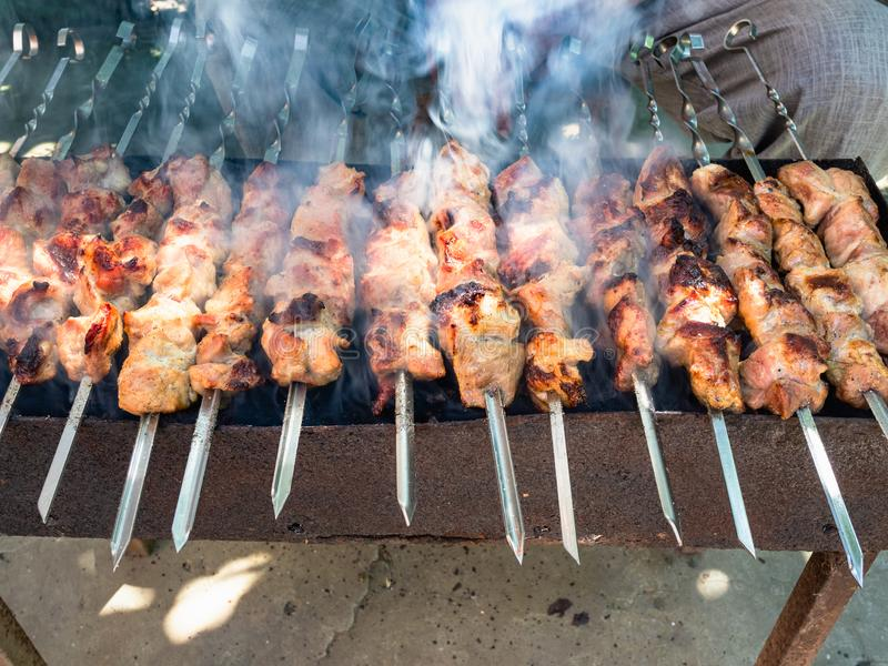 cooking many shish kebabs on brazier outdoors royalty free stock photo