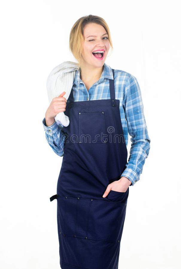 Cooking meat at low temperature for long time outdoors. Cooking meat in park. Barbecue master. Woman checkered shirt and. Apron for cooking white background royalty free stock photography