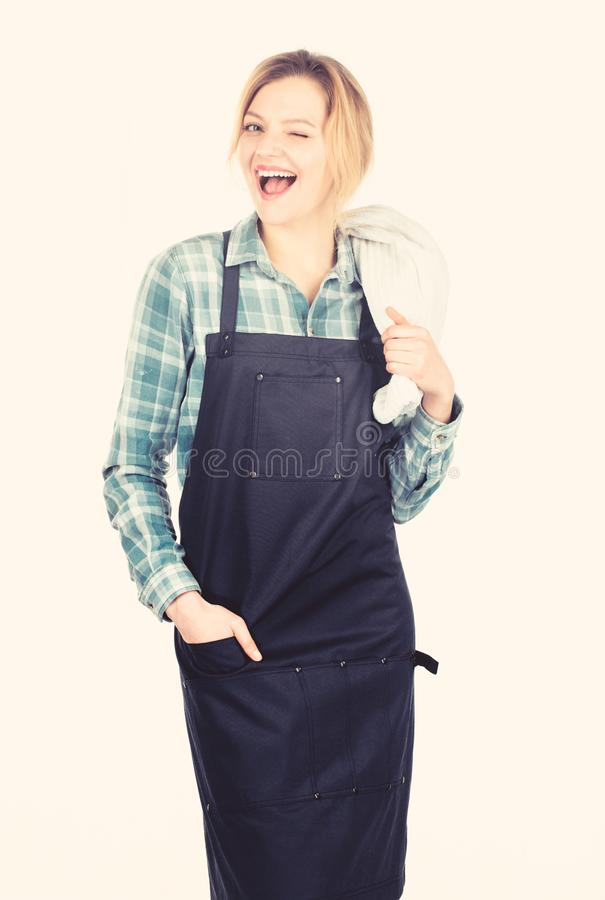 Cooking meat at low temperature for long time outdoors. Cooking meat in park. Barbecue master. Woman checkered shirt and. Apron for cooking white background stock images
