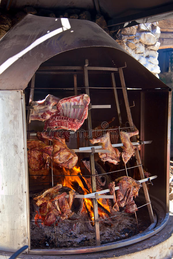 Cooking meat with open fire. Special greek oven with meat cooking with open fire stock image