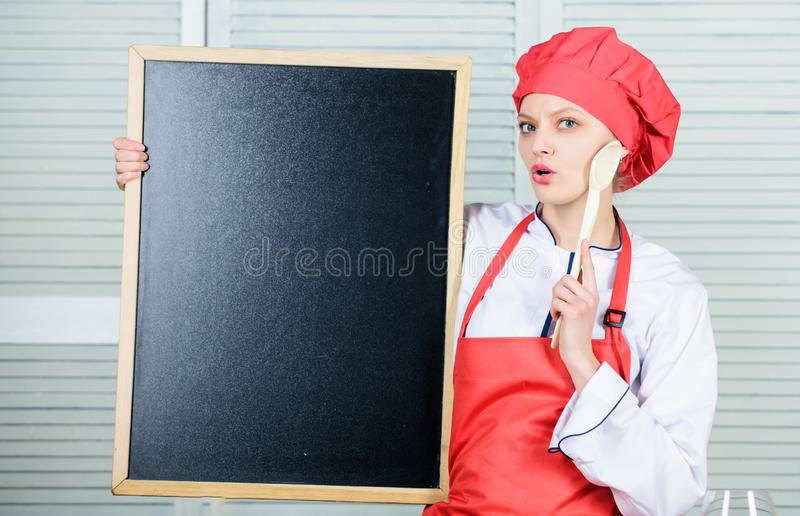 Cooking menu for today. List ingredients cooking dish. Looking for colleagues. Staff wanted. Woman chef hat apron hold royalty free stock image