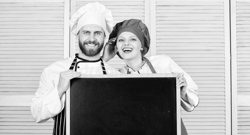 Cooking menu for today. List ingredients cooking dish. Family restaurant. Opening soon. Hiring staff. Woman and man chef stock photography