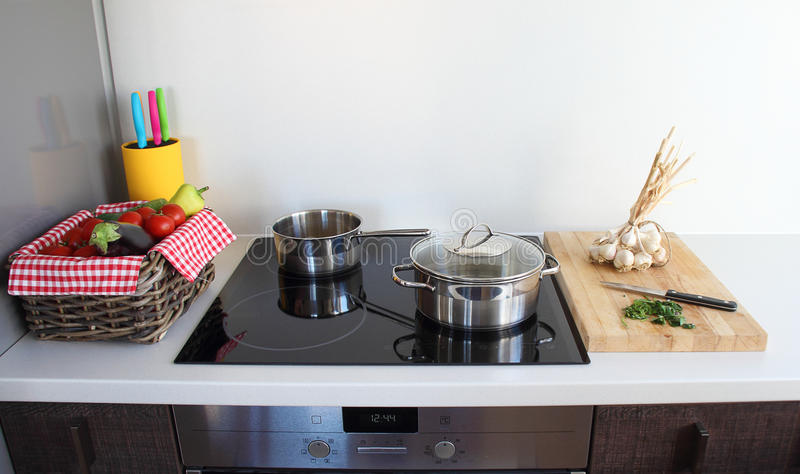 Cooking in modern kitchen stock photo