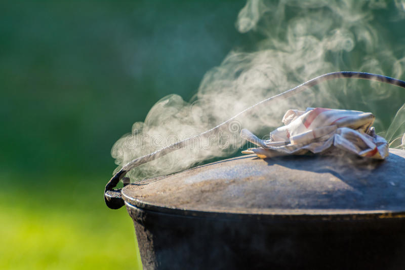 Cooking in the nature. Cauldron on fire royalty free stock photos