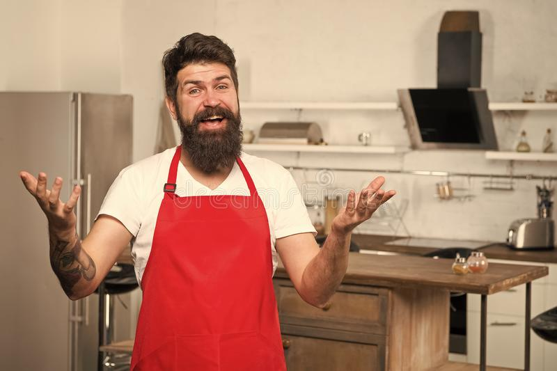 Cooking in new kitchen. Need culinary inspiration. Weekend begins from tasty breakfast. How to turn cooking at home into. Habit. Man bearded hipster red apron stock photos