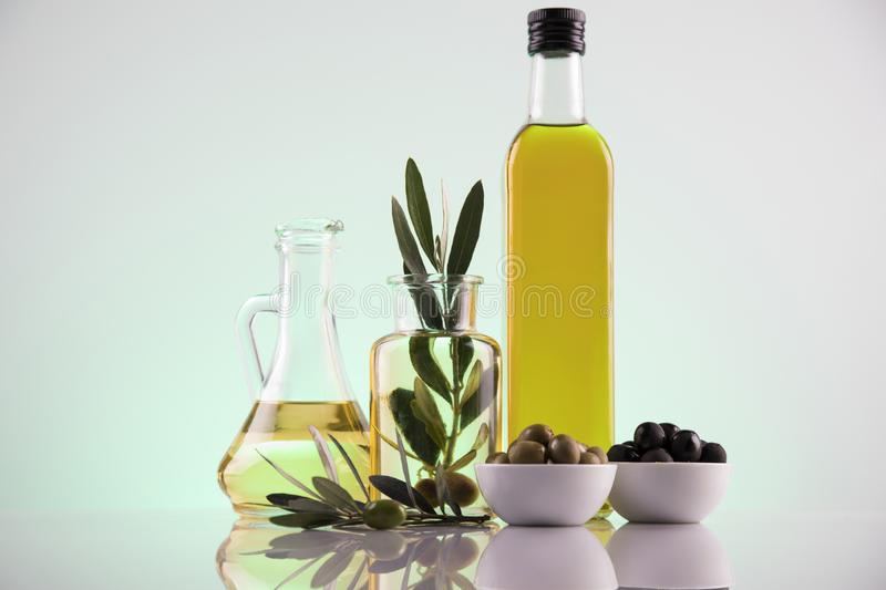 Cooking olive oils, bottles background stock photography