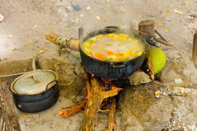 Cooking on an open fire in the tropics stock photo