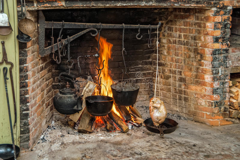 Cooking Warmers Vintage Fireplace ~ Cooking on open hearth stock photo image