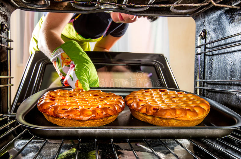 Cooking in the oven at home. stock photos