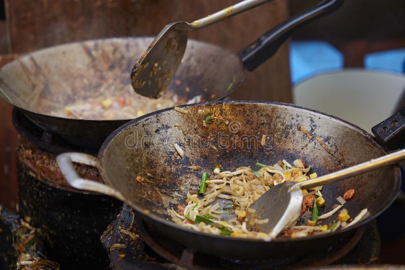 Cooking Pad Thai Goong Sod in pan, Fried noodle Thai style with prawns. Cooking Pad Thai Goong Sod in pan, Fried noodle Thai style with prawns, Street food of royalty free stock photo