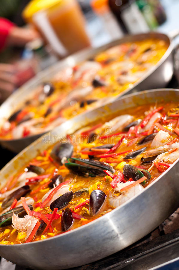 Cooking paellas royalty free stock image