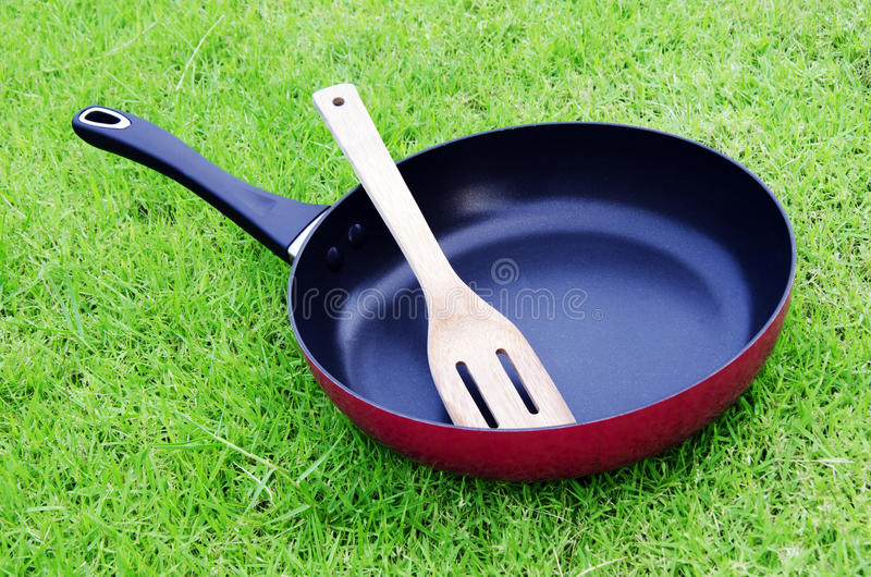 Cooking pan. Pan with grass in the background royalty free stock image