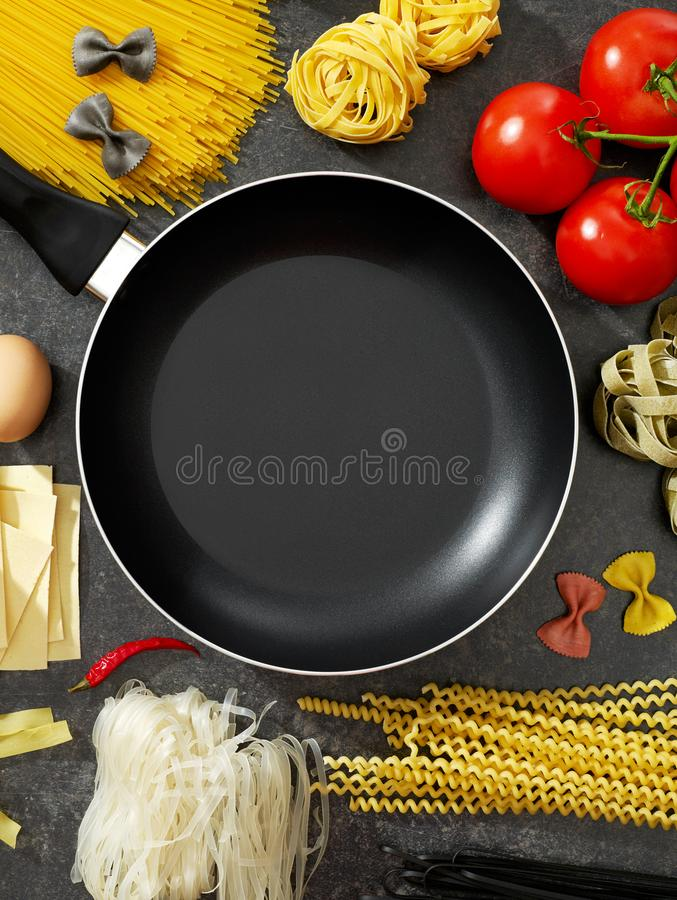 Cooking pan and ingredients stock images
