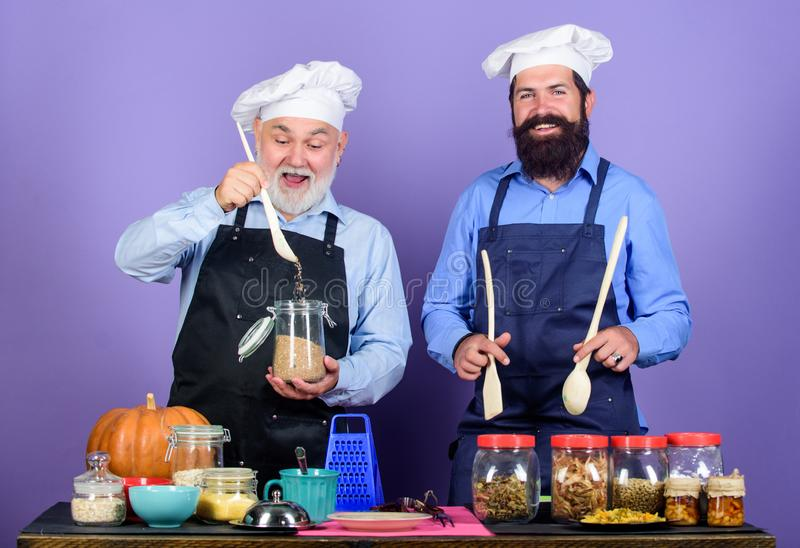 Cooking with passion. Healthy food cooking. mature senior bearded men in kitchen. Halloween recipe. cereals and royalty free stock photo