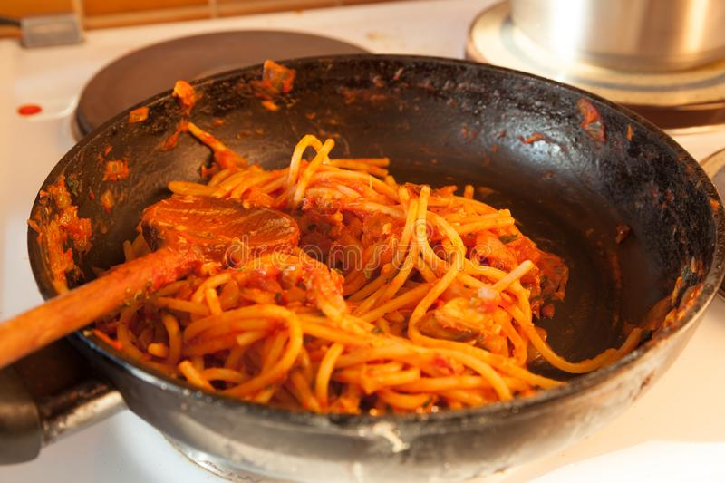 Cooking pasta with red sauce and tuna fish. Shot of cooking pasta with red sauce and tuna fish royalty free stock photo