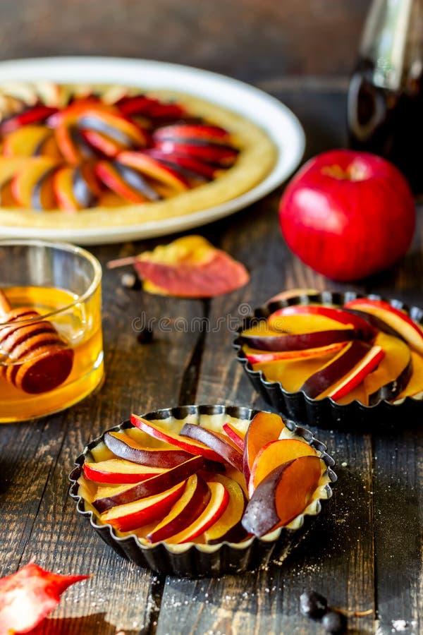 Cooking plum apple pie. Raw pie. Dough. Recipes. Vegetarian food. Dark photo stock photos