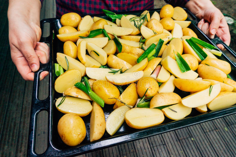 Cooking potatoes. In pan, ready to be roasted royalty free stock photos