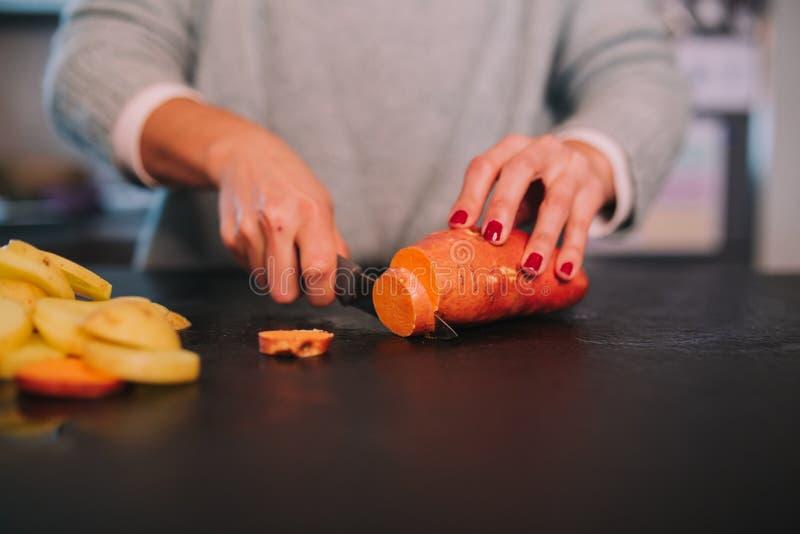 Cooking potatoes and sweet potatoes stock photos