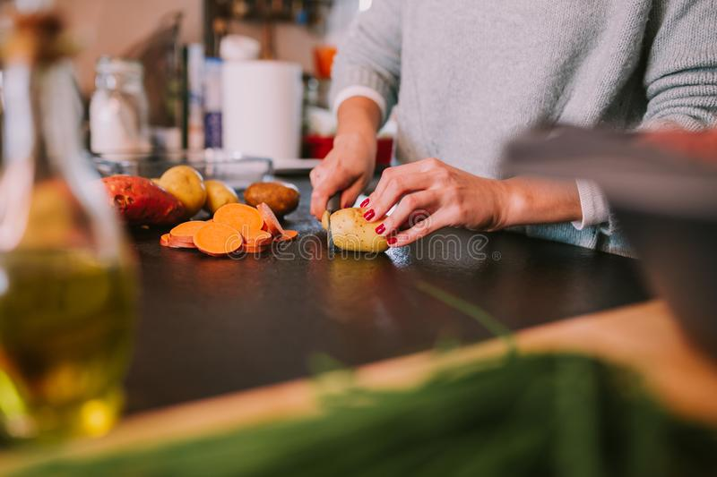 Cooking potatoes and sweet potatoes stock photography