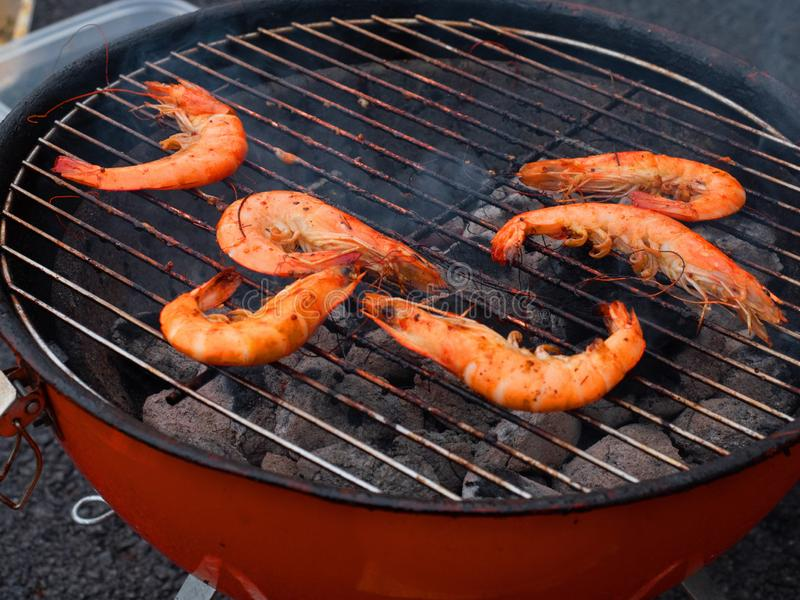 Cooking prawns on a barbecue. royalty free stock photos