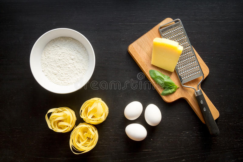 Cooking process of pasta on dark background top view.  royalty free stock photos