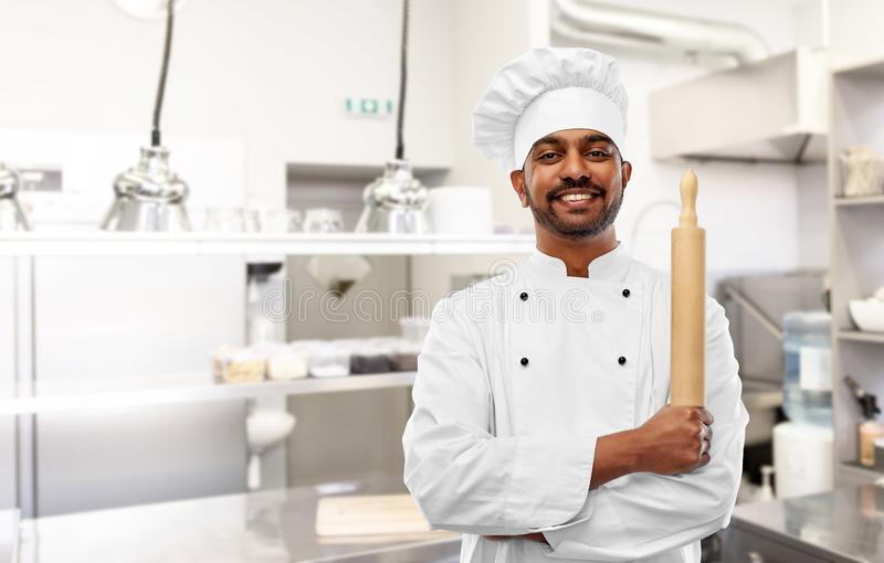 Indian chef or baker with rolling-pin at kitchen royalty free stock images