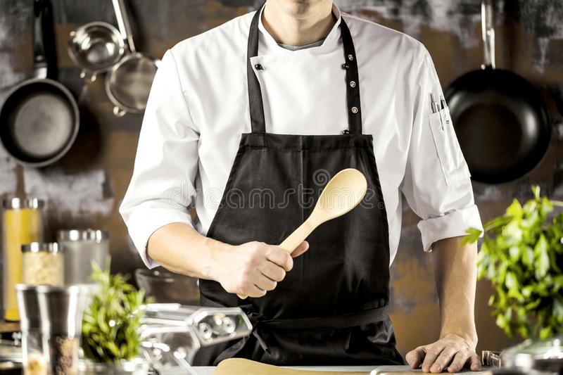 Cooking, profession and people concept - male chef cook making food at restaurant kitchen royalty free stock photo