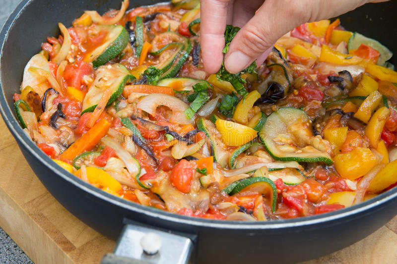 Cooking Ratatouille. Cooking the typical Provencal meal - Ratatouille. Typical Provencal food royalty free stock photo