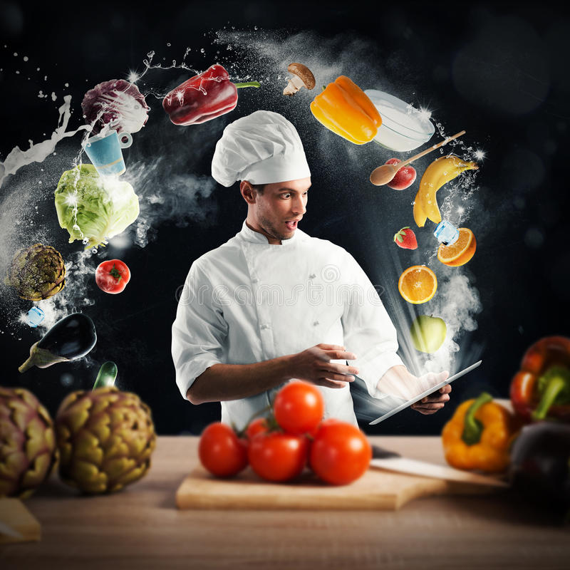 Cooking recipe from tablet. Chef reads a food recipe from the tablet royalty free stock photography