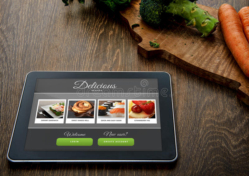 Cooking recipe on tablet pc. With vegetables on backround royalty free stock image